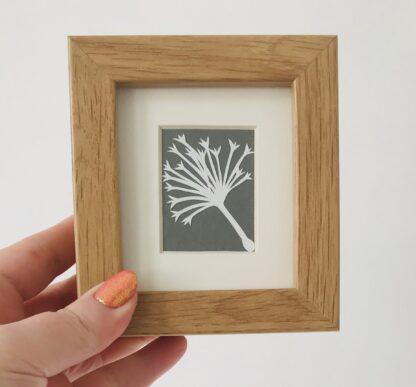 miniature dandelion paper cut by kppapercuts