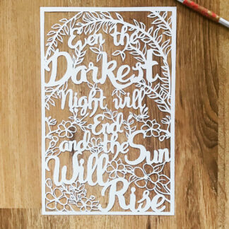 Positive quote paper cut. Even the darkest night will end and the sun will rise. Adorned with leaf and blossom motifs with brush lettering style wording.