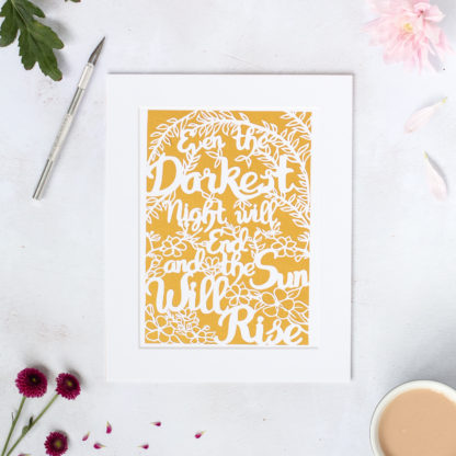 even the darkest night will end and the sun will rise paper cut quote on gold background