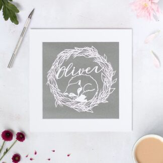 Personalised sleeping fox paper cut. Hand cut from white paper and mounted on a grey background