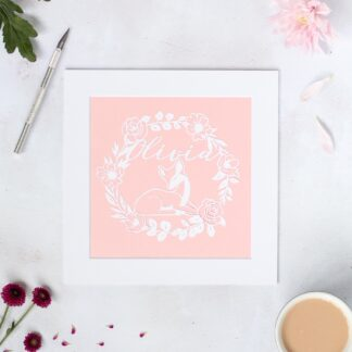 Personalised baby deer in a floral wreath paper cut. Hand cut from white paper and backed with a blush pink paper