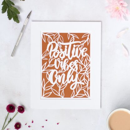 Positive Vibes Only hand cut paper quote in white with a copper background and leaf details by kppapercuts