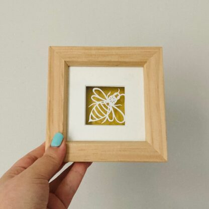 Miniature bee paper cut. hand cut in white and backed on gold paper in a wooden frame