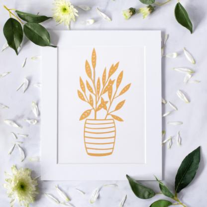 Golden house plant paper cut