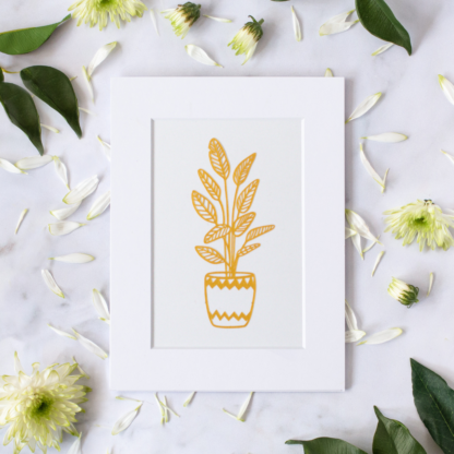 Small golden plant paper cut