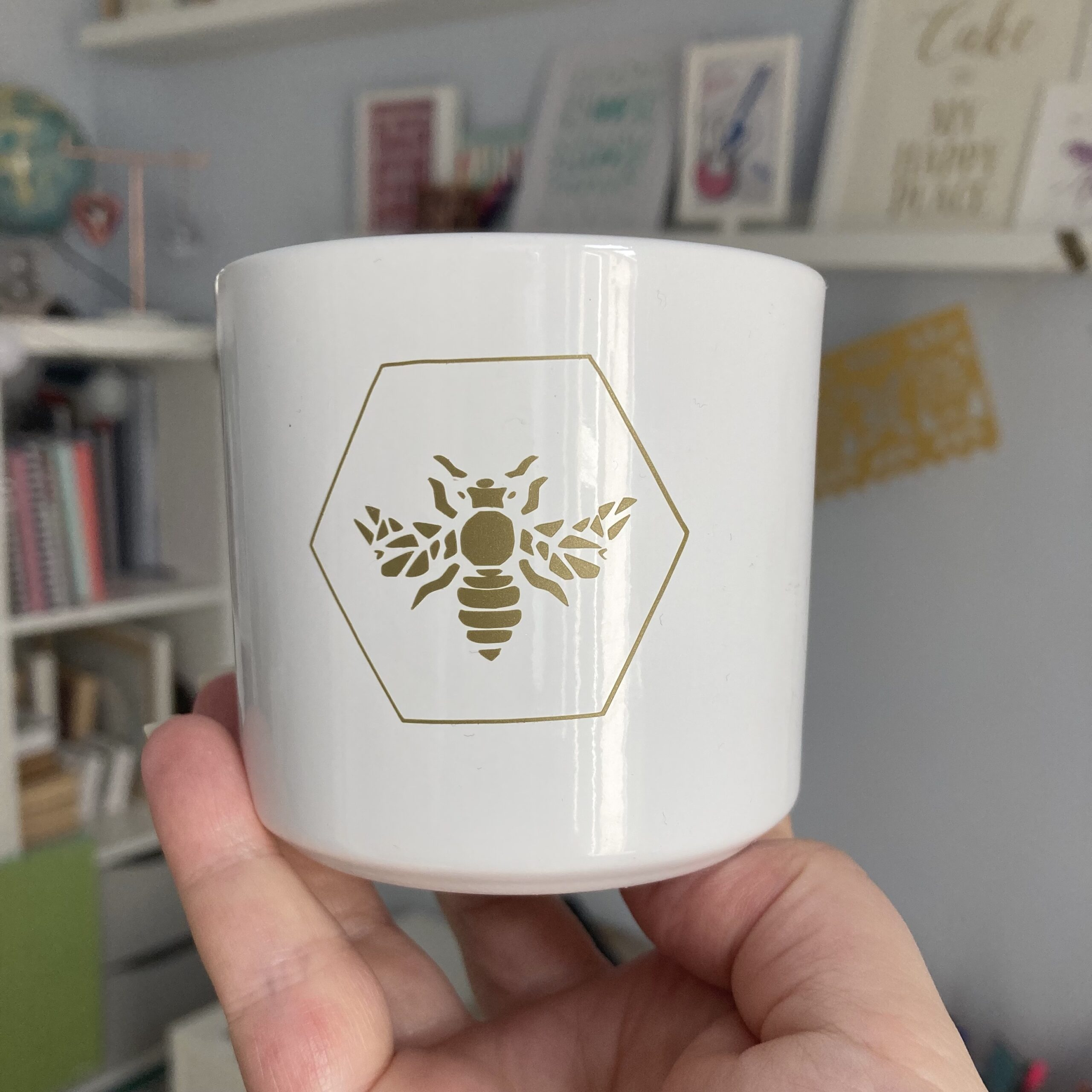 White ceramic pot with gold bee detail by kppapercuts